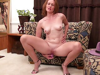 Shaved pussy matured Camille Johnson moans after a long time fingering her cunt